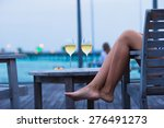 Young Woman With A Glass Of...