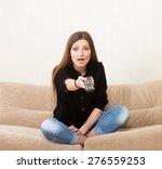 excited girl watching tv | Shutterstock . vector #276559253