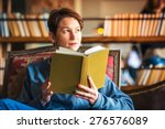 Young Beautiful Woman Reading A ...