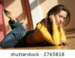 girl lying on stomach. | Shutterstock . vector #2765818