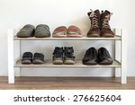 Six Pairs Of Shoes On A Shelf...