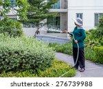 Asian Worker Woman Watering...