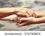 Hands Of An Elderly Senior...