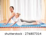 mother and daughter doing yoga... | Shutterstock . vector #276807314
