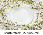Elegant Empty Plate Among...