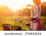 woman with her bike | Shutterstock . vector #276834656