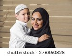 arabian mother holding her son  | Shutterstock . vector #276860828