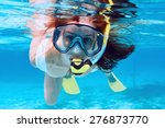 woman with mask snorkeling in... | Shutterstock . vector #276873770