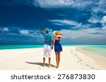 couple in blue on a tropical... | Shutterstock . vector #276873830