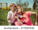 beautiful mother and baby... | Shutterstock . vector #277005530