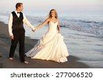 happy wedding couple walking on ... | Shutterstock . vector #277006520