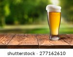 Beer In Glass On Wooden Table...