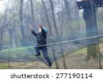 Child Climbing Into A Net At...