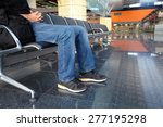 man in airport lounge sitting... | Shutterstock . vector #277195298