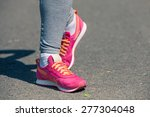 athletic pair of feet on a grass | Shutterstock . vector #277304048