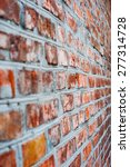 Small photo of blurred brick wall of red brick appearance at an acute angle