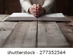 woman hands on bible. she is... | Shutterstock . vector #277352564