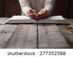woman hands on bible. she is... | Shutterstock . vector #277352588