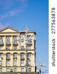 Small photo of Beautiful old building fa�§ade with stucco molding and street lamps before against blue sky background. Moscow, Russia.