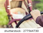 Foreground Of Baby Carriage An...