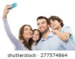 Family Taking Photo Of...