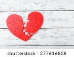 Red Puzzle Heart On White...