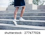 a young woman is walking up the ... | Shutterstock . vector #277677026