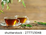 Stock photo cups of green tea on table on wooden background 277715048