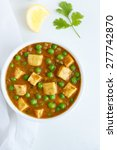 Small photo of Mutter Paneer , Indian Dish Cottage cheese and Peas immersed in an Onion Tomato Gravy