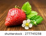Ripe Strawberry With Leaf And...