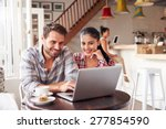 young couple using laptop in a...   Shutterstock . vector #277854590