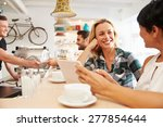 two women at a meeting in a cafe | Shutterstock . vector #277854644