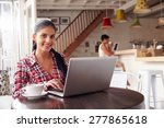young woman using laptop in a... | Shutterstock . vector #277865618