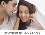 couple romancing in bed | Shutterstock . vector #277957799
