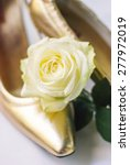 wedding shoes and white rose | Shutterstock . vector #277972019