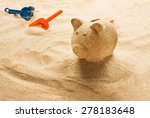 piggy bank sculpted in sand on...