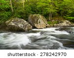 Two Large Boulders Sit On The...