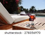 soft drink in a beach chair by...