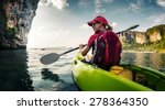 young lady paddling the kayak... | Shutterstock . vector #278364350