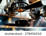 Close-up of espresso pouring from coffee machine. Professional coffee brewing - stock photo
