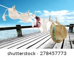Stock photo hat and white bikini with red glasses 278457773