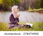 muslim woman reading holy quran | Shutterstock . vector #278474900