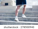 a young woman is walking up the ... | Shutterstock . vector #278500940
