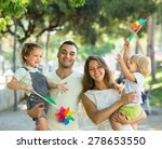 cheerful young parents holding... | Shutterstock . vector #278653550