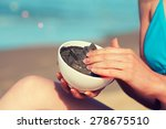 woman smearing mud mask on the... | Shutterstock . vector #278675510