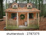cabin in woods decorated for xmas - stock photo