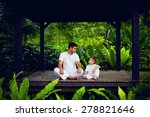Small photo of father teaches son to find inner balance