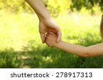 a the parent holding the hand... | Shutterstock . vector #278917313