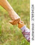 hand of parent and child | Shutterstock . vector #278934134