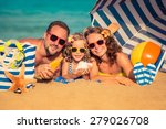 happy family lying on the beach.... | Shutterstock . vector #279026708